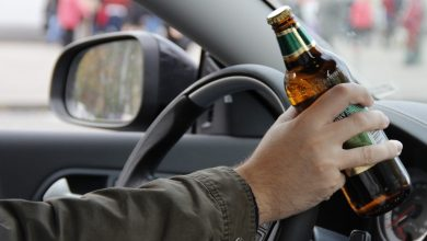 Сбутылкой за рулем