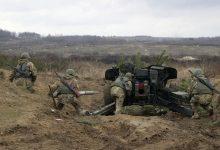 Военнослужащие артилерийского расчёта