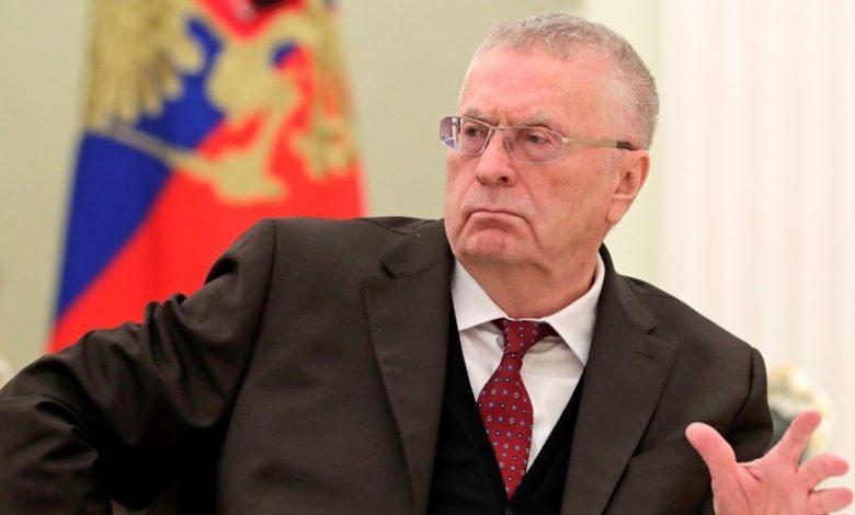 Лидер ЛДПР Жириновский на фоне флага России