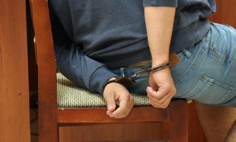 задержанный в наручниках, СК раскрыл подробности уголовного дела